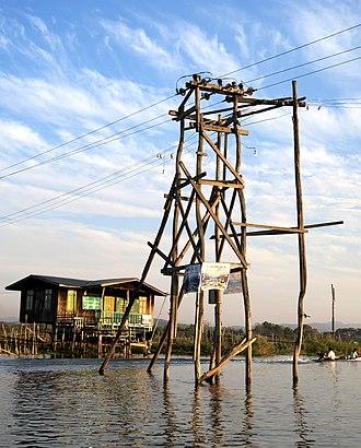 Lattice tower - Wooden lattice transmission tower in inle Lake (Myanmar).