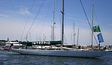 Photograph of the yacht Intrepid at her moorings, sails stowed.