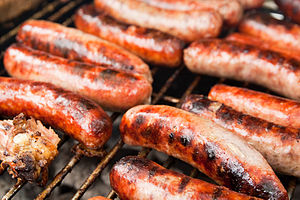 Italian sausage - Italian sausages on a grill