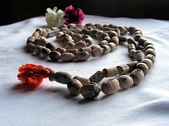 Japamala - Japa mala, made from tulasi wood, with head bead in foreground