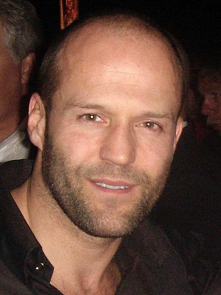 Statham posing with a fan at the ShoWest – Lionsgate Luncheon in March 2007. - Jason Statham