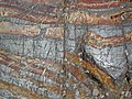 Jaspilite banded iron formation (Soudan Iron-Formation, Neoarchean, ~2.69 Ga; Stuntz Bay Road outcrop, Soudan Underground State Park, Soudan, Minnesota, USA) 51 (19037930508).jpg