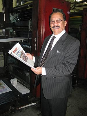 Jayam Rutnam - Rutnam holding the San Gabriel Valley Examiner, a weekly publication from Glendora, California.