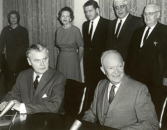 Grand Coulee Dam - Canadian Prime Minister John Diefenbaker (seated left) and US President Dwight Eisenhower at the signing of the Columbia River Treaty, 1961