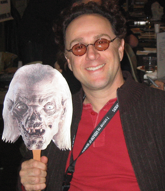 John Kassir - Kassir holding a picture of the Crypt Keeper on November 11, 2006