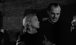 On the Waterfront - Karl Malden as Father Barry with Eva Marie Saint.