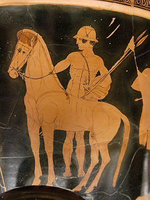 Castor and Pollux - Castor depicted on a calyx krater of c. 460–450 BC, holding a horse's reins and spears and wearing a pilos-style helmet