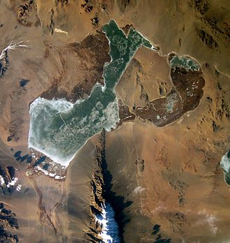 Khar-Us Lake - Khar-Us Lake frozen, Khar Lake fragment is at the western edge of the image, Jargalant-Khaikhan Mounts are south from Lake Khar-Us (NASA astronauts image 2002-12-13).