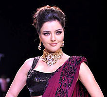 Kristina Akheeva walks the ramp for D. Navinchandra at IIJW 2013.jpg
