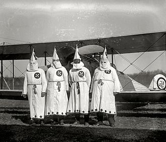 African-American socialism - March 17, 1922. Members of the Ku-Klux-Klan about to take off with literature which was scattered over the Washington's Virginia suburbs during a Klan parade.