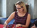 Kyrsten Sinema signing holiday cards for troops in 2016. 01.jpg