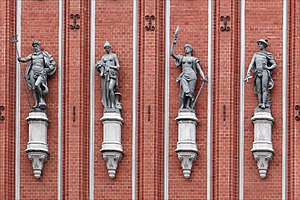 August Volz - Allegorical sculptures on the facade of the House of the Blackheads, made by Volz