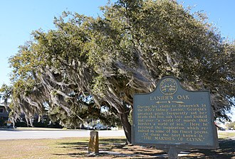 Sidney Lanier - Sidney Lanier sat under an oak tree at this location and was inspired to write the poem The Marshes of Glynn.  (The original oak tree died.)