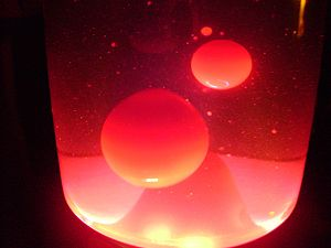 Wax bubbles in a lava lamp during operation