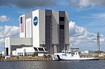 Liberty Star ship in front of Vehicle Assembly Building.jpg