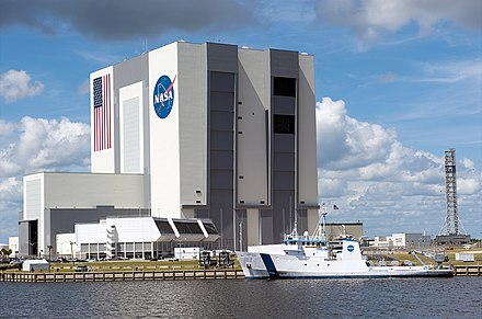 Vehicle Assembly Building and Launch Control Center at Kennedy Space Center Liberty Star ship in front of Vehicle Assembly Building.jpg