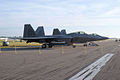 Lockheed-Martin F-22A-30-LM Raptors 05-099 and 05 107 RSideFronts Dawn SNF 04April2014 (14399713918).jpg