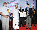 M. Veerappa Moily gave away the PetroFed Awards 2012, at the PetroFed Oil & Gas Industry Awards Ceremony, in New Delhi. The Secretary, Ministry of Petroleum & Natural Gas, Shri Vivek Rae and the Chairman (3).jpg