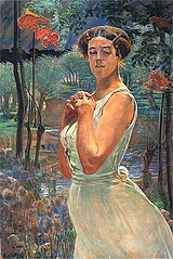 A woman in a grove.