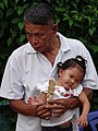Man and Child - Walking Street Market on Th Talad Gao - Lampang - Thailand (34406520053).jpg