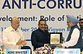 Manmohan Singh being presented a memento by the Director, CBI, Shri A.P. Singh, at the 19th Conference of CBI and State Anti-Corruption Bureaux, in New Delhi. The Union Home Minister, Shri Sushil Kumar Shinde is also seen.jpg