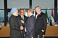Manmohan Singh with the Prime Minister of Canada, Mr. Stephen Harper, the President of South Africa, Mr. Jacob Zuma and the Prime Minister of Ethopia, Mr. Meles Zenawi, at the plenary session of G-20 Summit, in Cannes.jpg