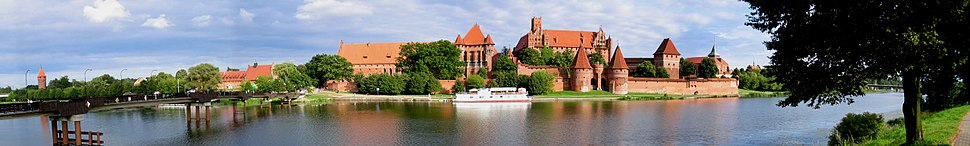 The Castle of the Teutonic Order in Malbork, Poland, is an example of medieval fortresses and built in the typical style of northern Brick Gothic. On its completion in 1406 it was the largest brick castle in the world.
