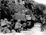 Marines take cover behind medium tank