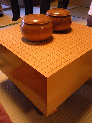 Go equipment - Wooden Go bowls on a Japanese-style floor board