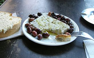 Meze - Simple Greek meze: cheese and olives (feta cheese drizzled with olive oil and sprinkled with oregano, served with kalamata olives and bread)