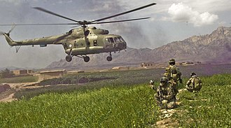 Farah Province - ISAF forces pull security for the safety of the pilots and team of an Mil Mi-17 helicopter as it leaves the Gulistan district in 2009.