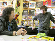 Mick Farren (left) with Patrick Boissel at the signing of the Bomp! book at Freakbeat Records in Sherman Oaks, California