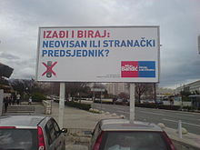 Billboard with blue and red letters on white background