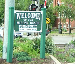Miller Beach - Sign next to Miller Station, welcoming visitors to Miller Beach.
