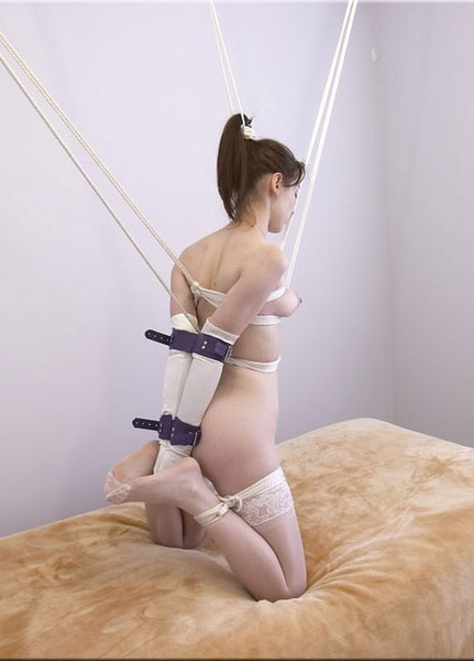 File:Model in vertical hogtie.jpg