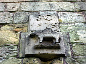 Andrew Corbet (died 1578) - Castled elephant and monogram of Sir Andrew Corbet. Part of medieval gatehouse, modified by Sir Andrew, viewed from north. Moreton Corbet Castle, Shropshire.