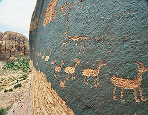 A petroglyph of a caravan of bighorn sheep near Moab, Utah, USA; a common theme in glyphs from the desert southwest