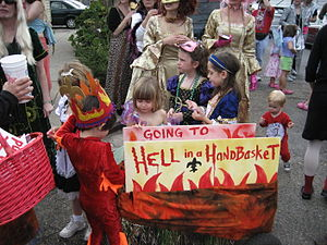 "To hell in a handbasket - New Orleans Mardi Gras day: wagon decorated as mini-float ""Going to Hell in a Handbasket"" with costume-wearing children"