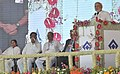 Narendra Modi addressing at the dedication ceremony of the 2.5 mt. Modernized and Expanded IISCO Steel Plant to the nation, at Burnpur, in West Bengal. The Chief Minister of West Bengal.jpg
