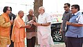 Narendra Modi being welcomed by the Governor of Uttar Pradesh, Shri Ram Naik, the Union Minister for Road Transport & Highways, Shipping and Water Resources, River Development & Ganga Rejuvenation.JPG