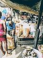 Nigerian local food seller and buyer market scene.jpg