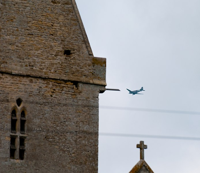File:Normandy 10 Angoville-au-Plain Liberty Jump Team passing church (4824159497).jpg