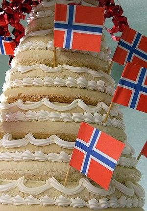 Kransekake - Closeup of a kransekake that is decorated with Norwegian flags
