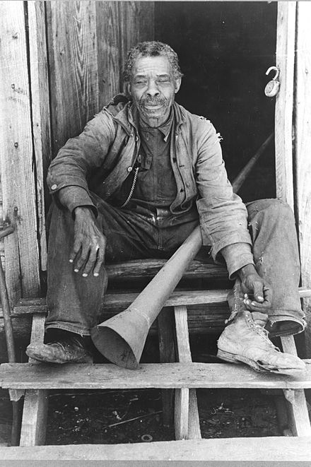 Former slave with horn historically used to call slaves, Texas, 1939. Photo by Russell Lee. Old Freedman with old slave horn Texas 1939.jpg