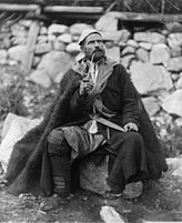 Old peasant with dagger and long smoking pipe, Mestia, Svanetia, Georgia (Republic).jpg