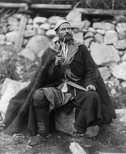Georgian peasant in Mestia, c. 1888 Old peasant with dagger and long smoking pipe, Mestia, Svanetia, Georgia (Republic).jpg