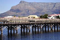 Old wooden bridge spanning the Milnerton Lagoon.jpg