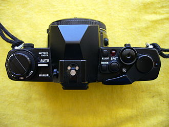 Olympus OM-4 - Top view of an OM-4 camera body, showing controls
