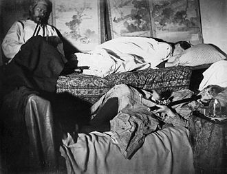 Opium den - Two women and a man smoking in an opium den, late 19th century
