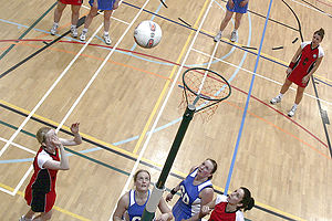 Netball in Scotland - Inter-county netball game: Orkney (red) vs Shetland 'A' (blue).